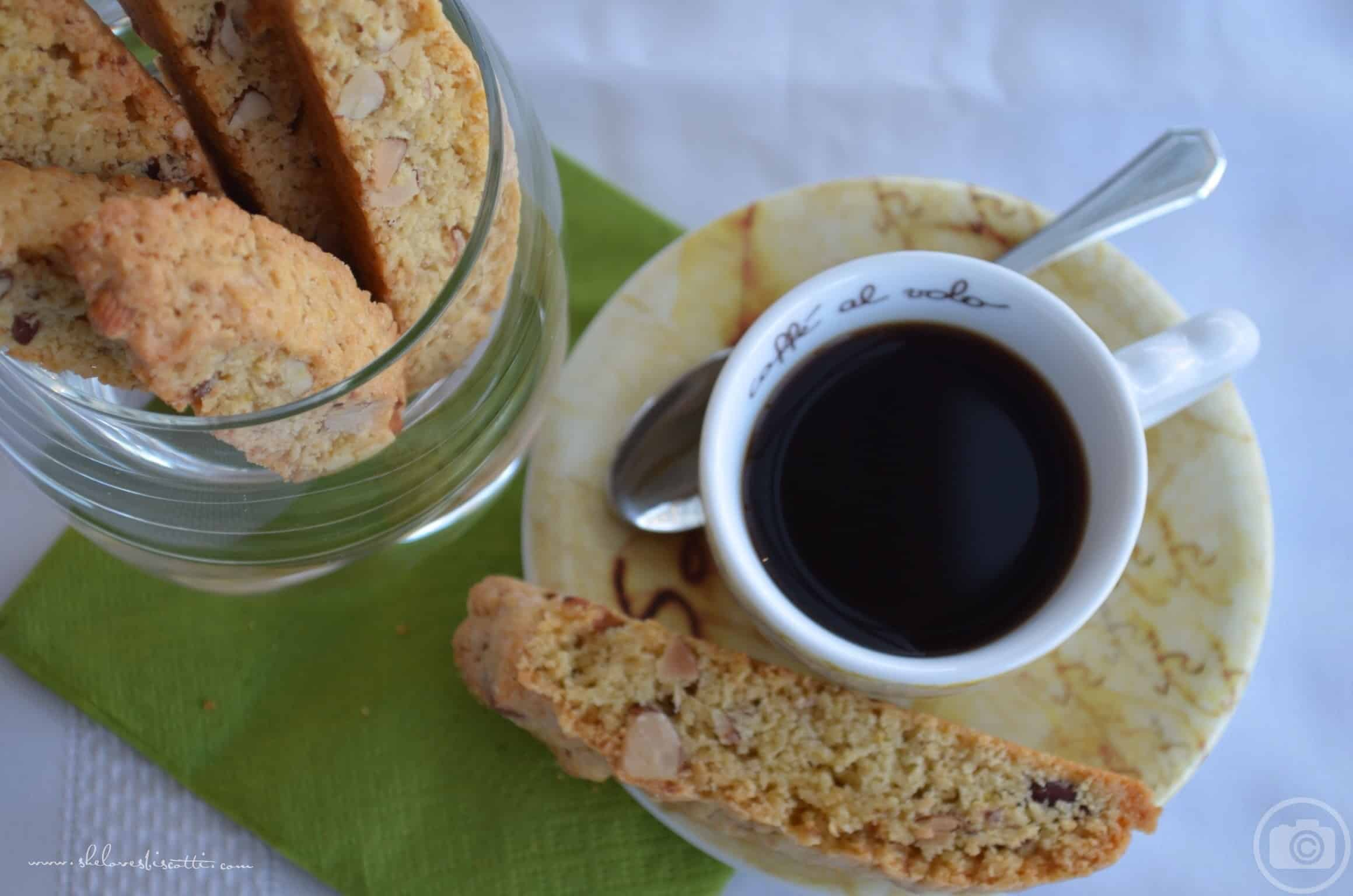 An overhead view of an espresso cup and almond biscotti.