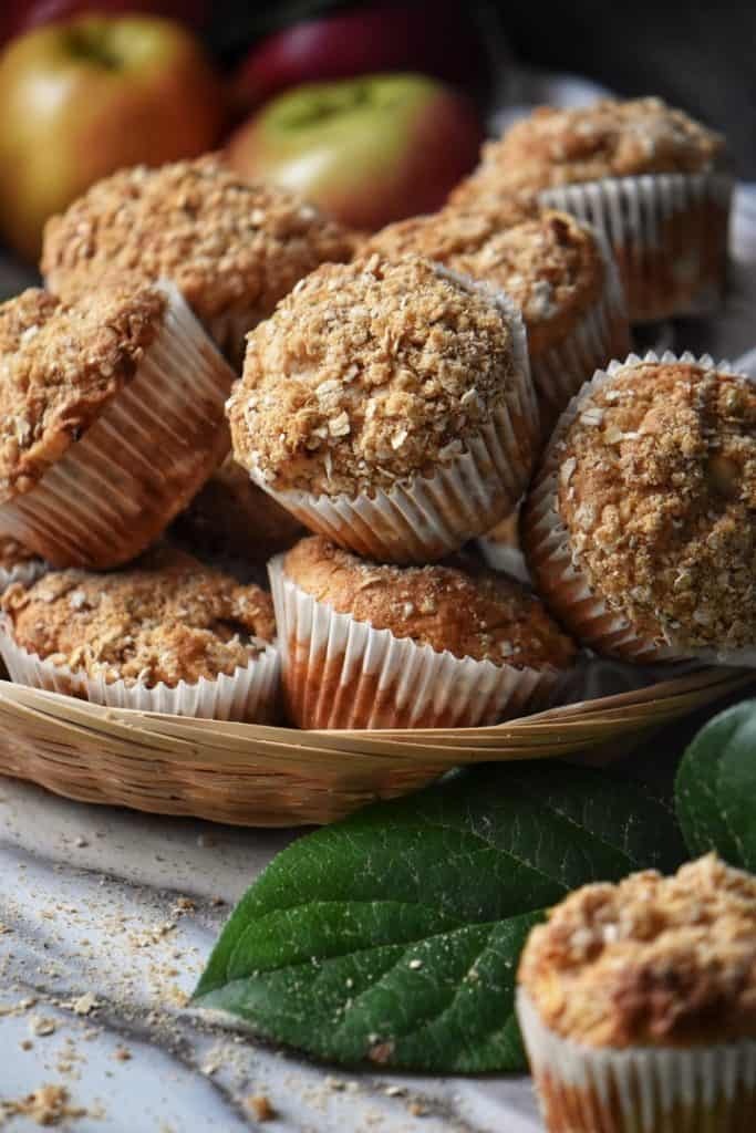 The complete apple muffins recipe in a wicker basket.