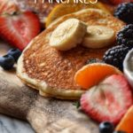 Buttermilk pancakes surrounded with fresh fruit.