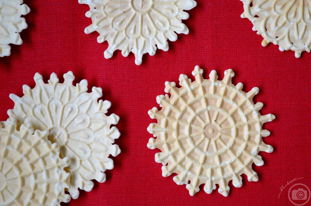 Pizzelle are shown on a red background.