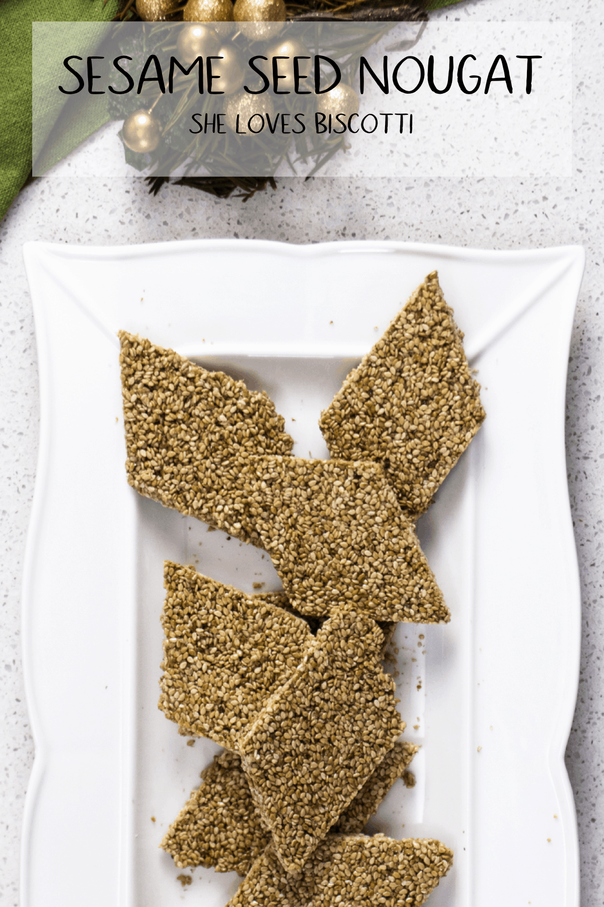 Sesame Seed Nougat -a Southern Italian sweet that can easily  be made at home. If you like crunchy sesame bars, you are going to love these! #shelovesbiscotti #sesameseeds #sesamesnaps #candy #holidaytreat #Italiancandy #cubbaita #Confetto #pastelli