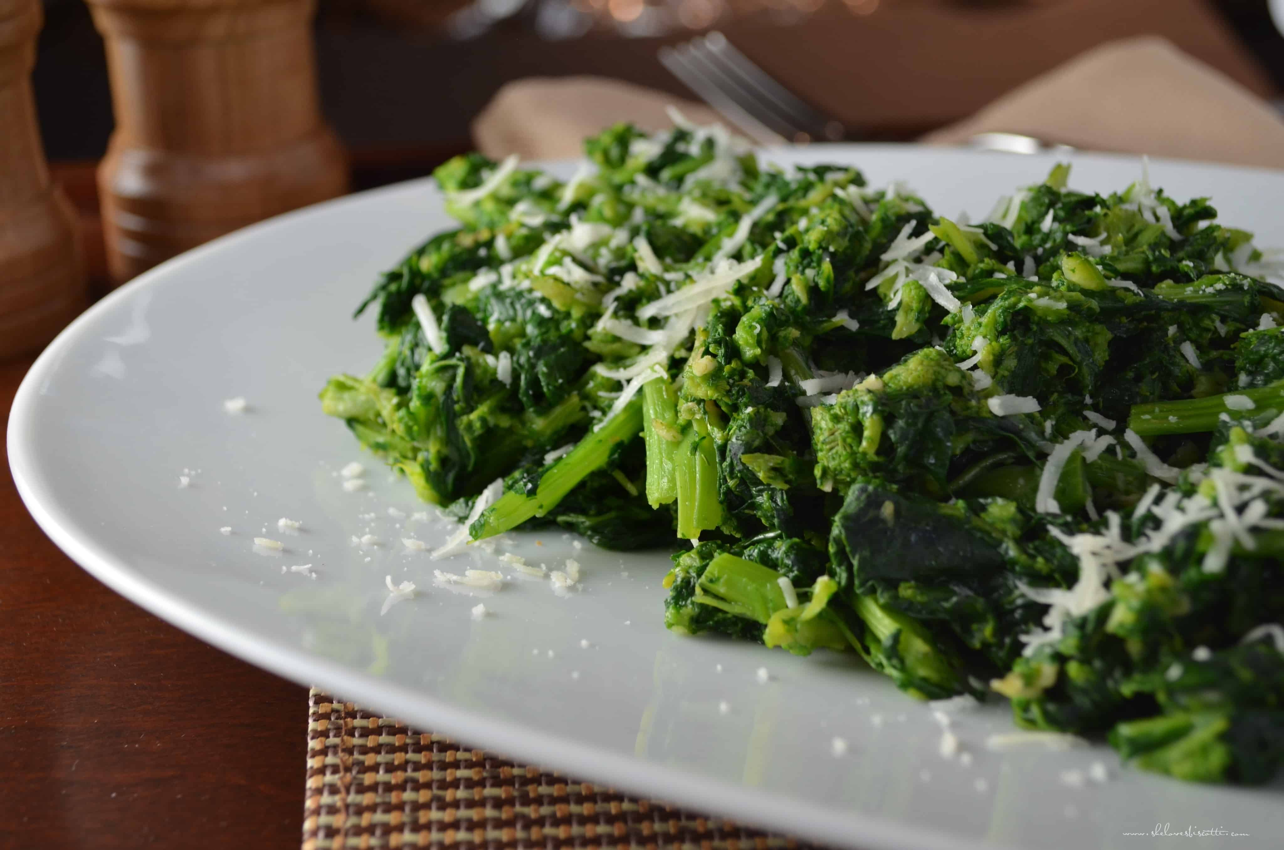 Italian-Style Garlicky Broccoli Rabe served on a large white platter.