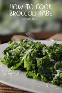 Cooked Italian broccoli rabe on a white plate.