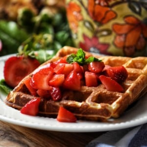 Macerated strawberries on waffles.