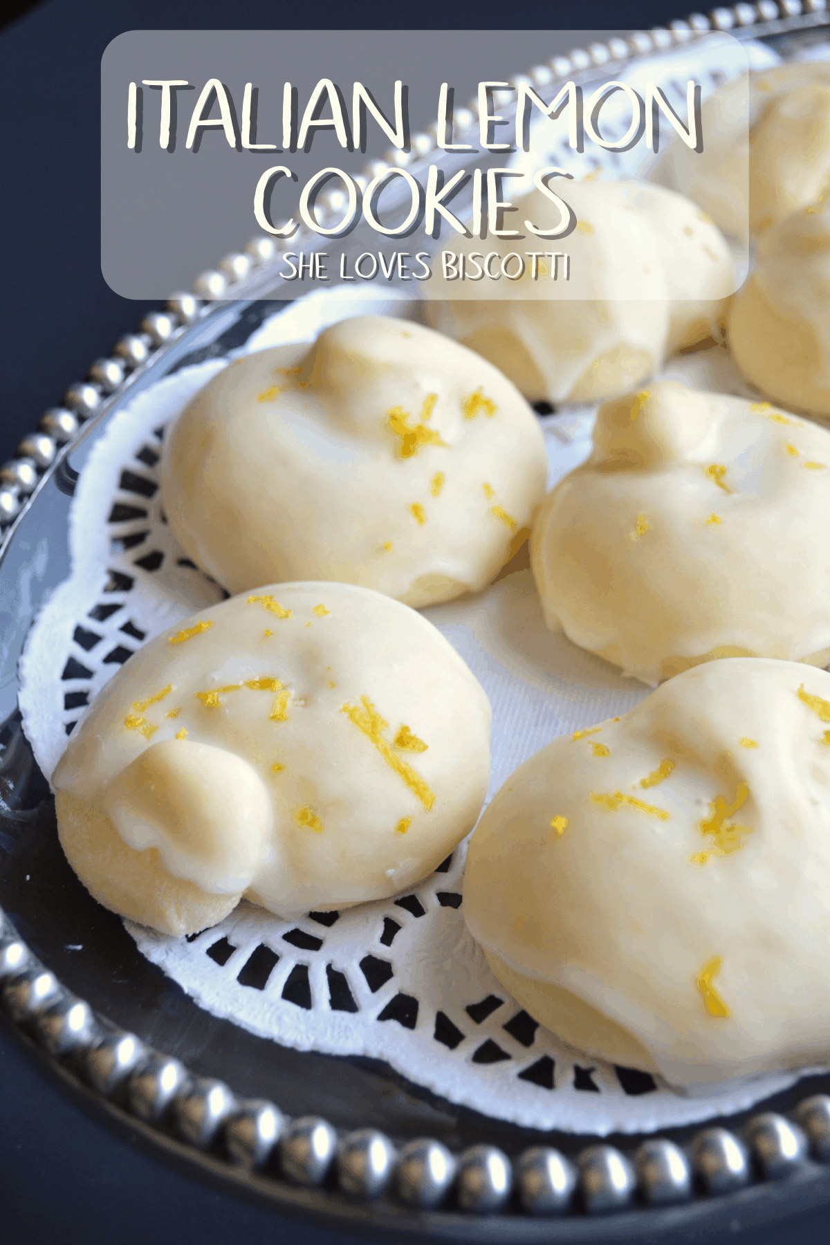Whether you call them Tarallucci or Italian Lemon Cookies, they make the best Christmas cookies! Soft and cake-like, with a refreshing burst of lemon flavor. #shelovesbiscotti #Italiancookies #easycookierecipe #easycookie #lemoncookies #Christmascookie #ItalianChristmascookies #Italianlemoncookies