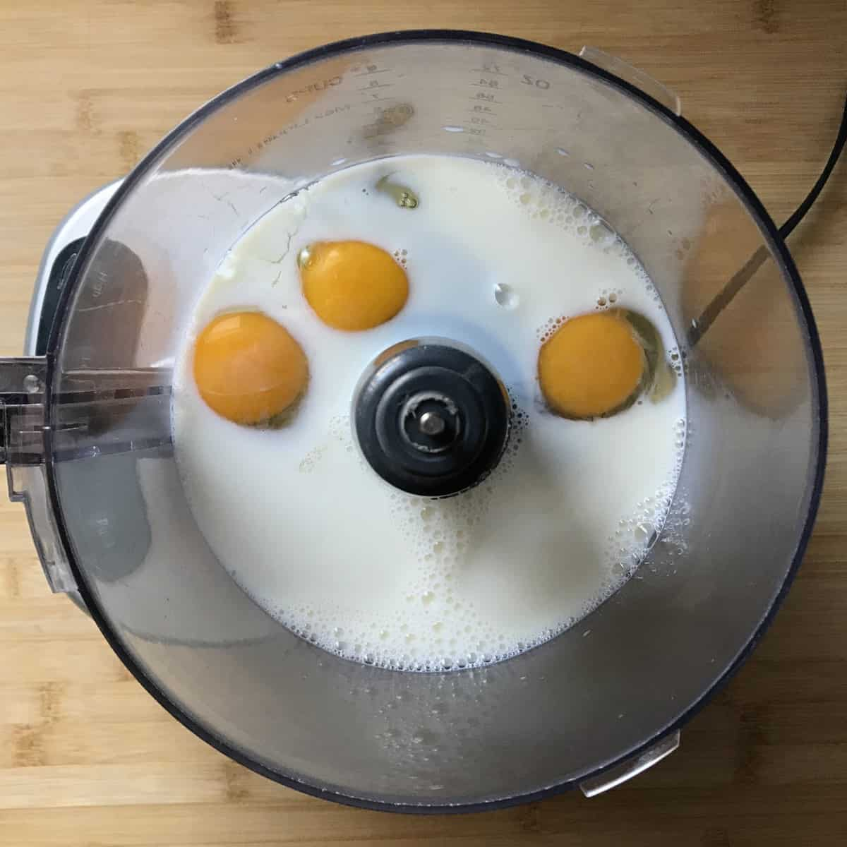 Making this sweet crepe recipe begins with eggs and milk in a food processor.