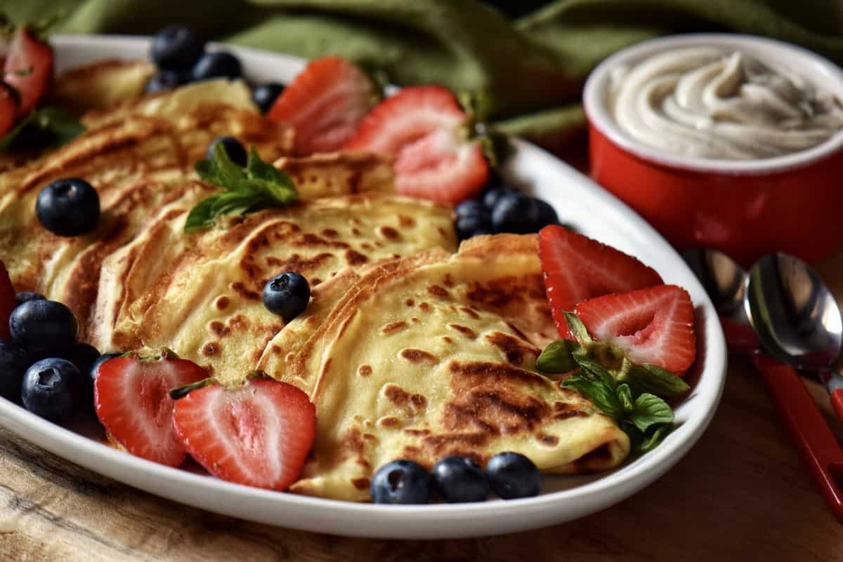Sweet crepes with fresh fruit and ricotta.