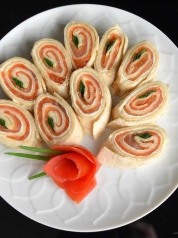 Smoked Salmon Pinwheels on a white dish.