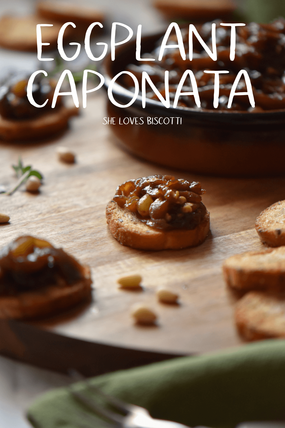 Eggplant Caponata is so easy to make and is just perfect for your appetizer board. #shelovesbiscotti #caponata #eggplantcaponata #eggplant #easyappetizer #appetizers #pinenuts #roastedvegetables