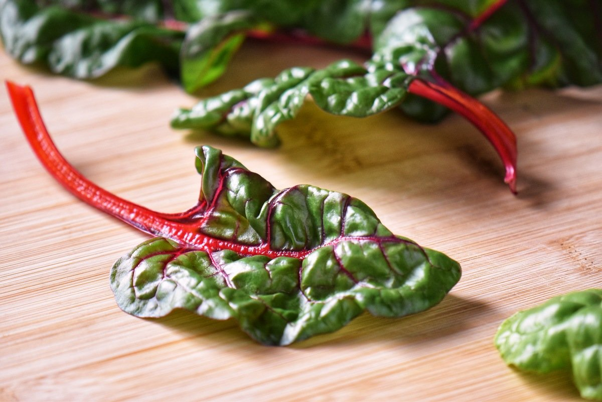 Rainbow chard on a wooden board.