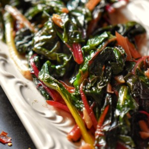 Sauteed Rainbow chard in a white plate.