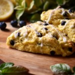 Iced blueberry scones on a wooden surface.