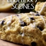 Blueberry Scones with blueberries on a wooden board.