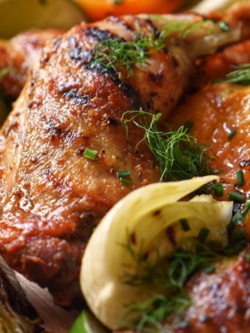 Grilled chicken legs with fennel and peaches.