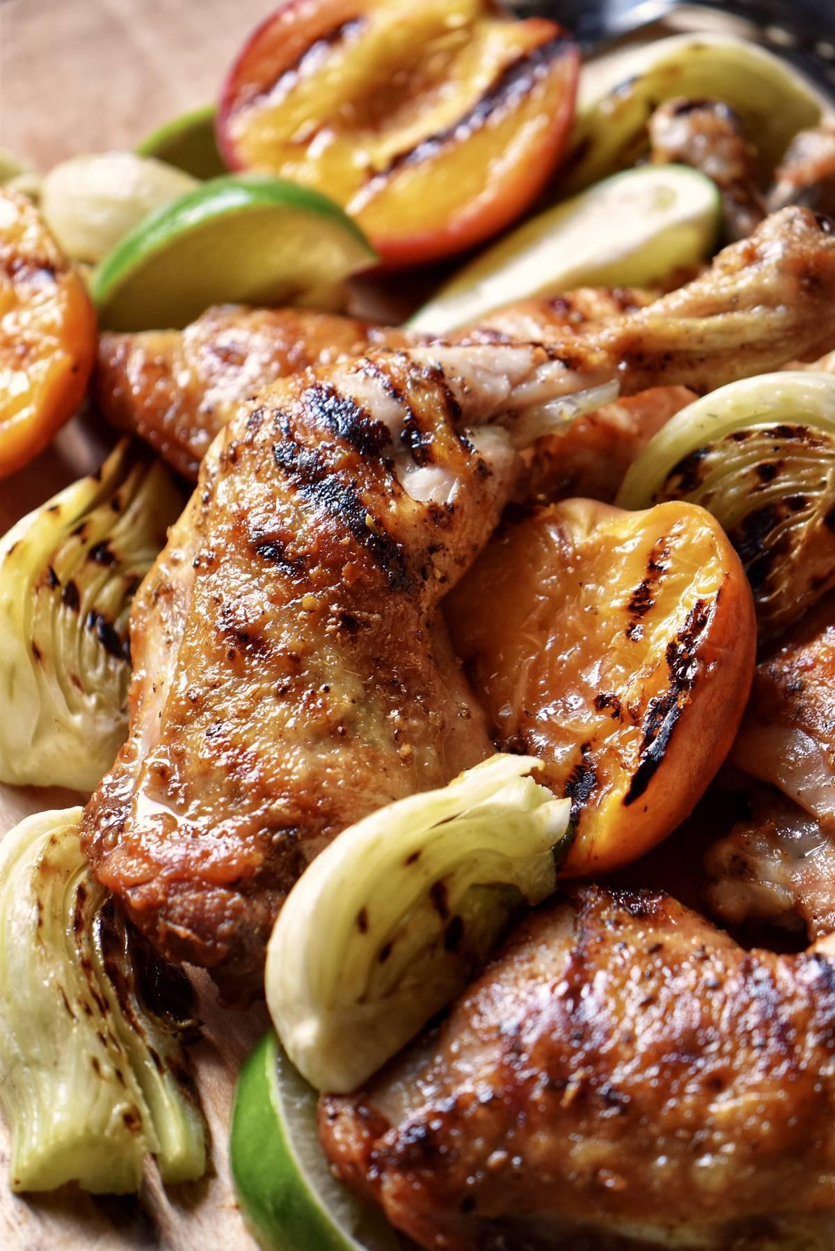 An close up photo of a grilled chicken leg quarter.