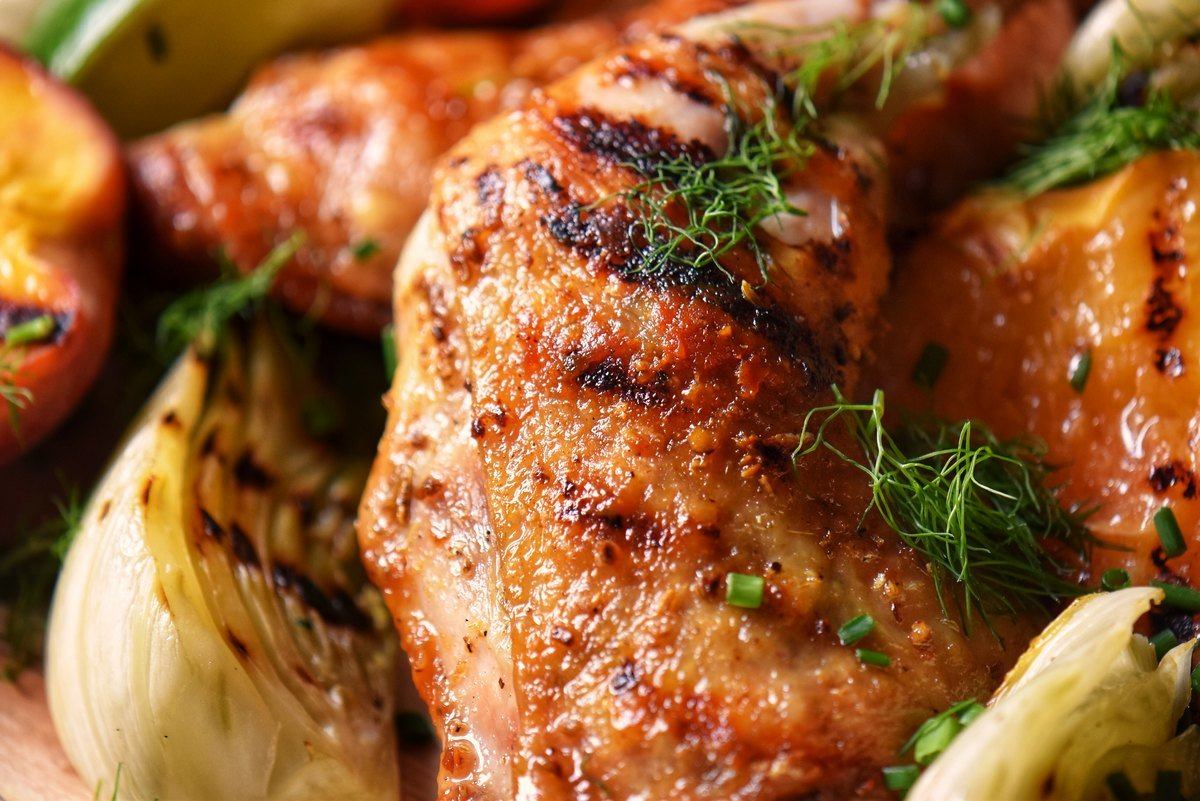 A close-up photo of grilled chicken with fennel.