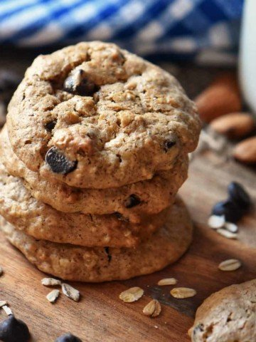A stack of Oatmeal Almond Butter Cookies on a wooden board.