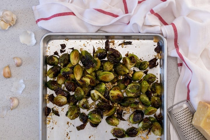 Roasted Brussels sprouts with garlic on a sheet pan.