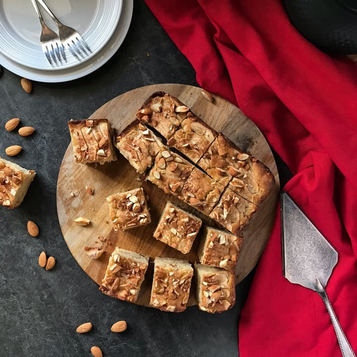 The best apple cake recipe ever cut into sixteen squares.