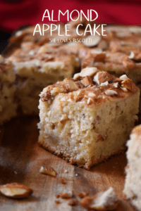 A close up shot of the moist interior of a piece of almond apple square cake.