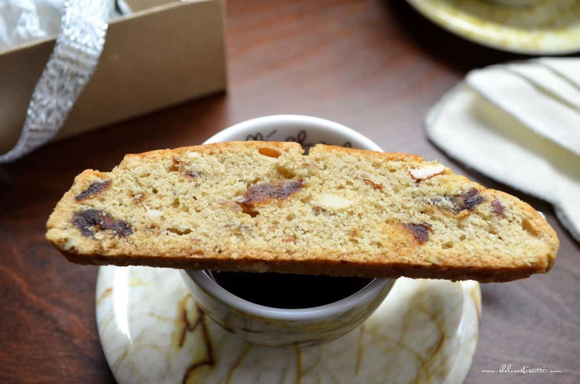 A Simple Almond Date Biscotti set on an espresso cup.