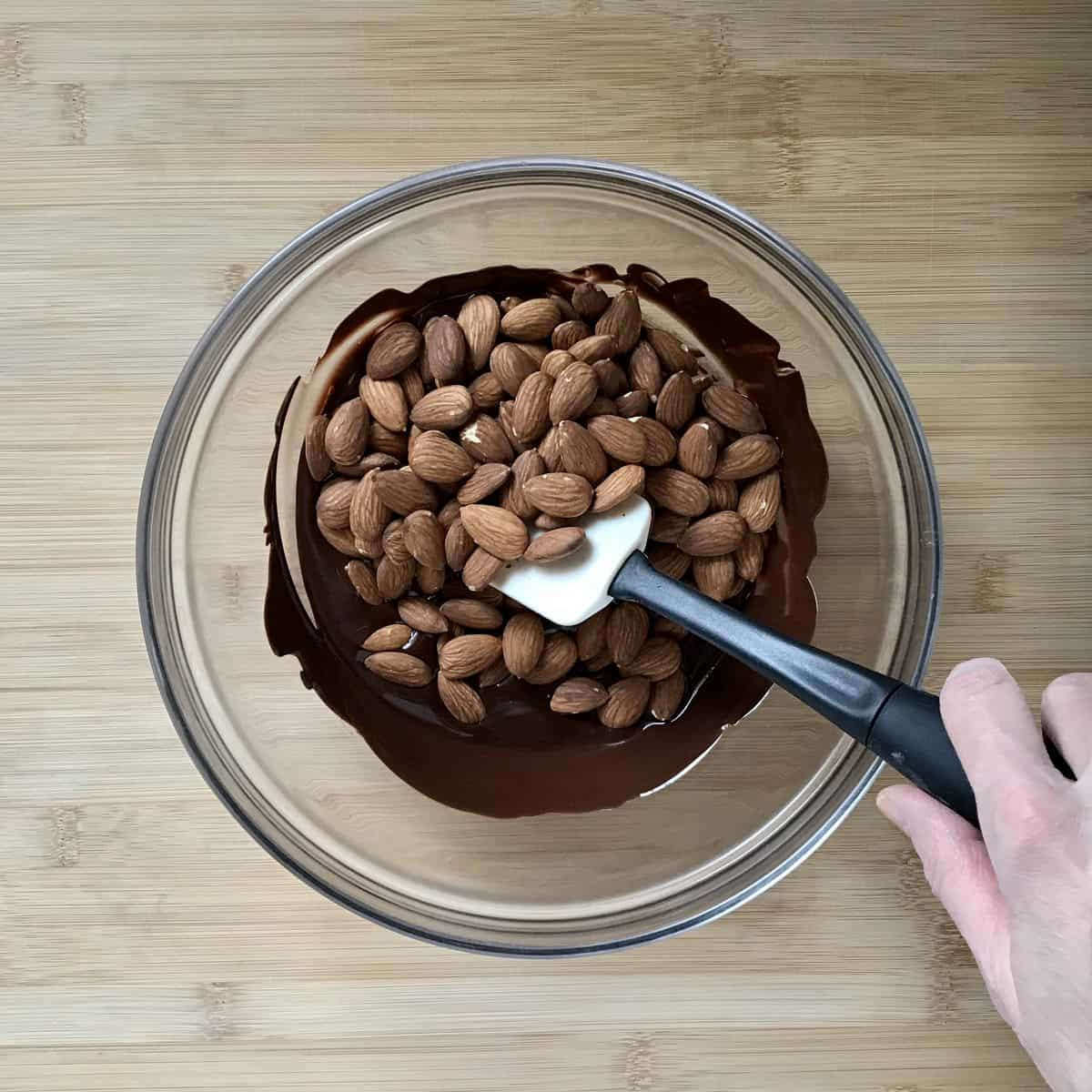 The mixture of chocolate and almonds in a bowl.