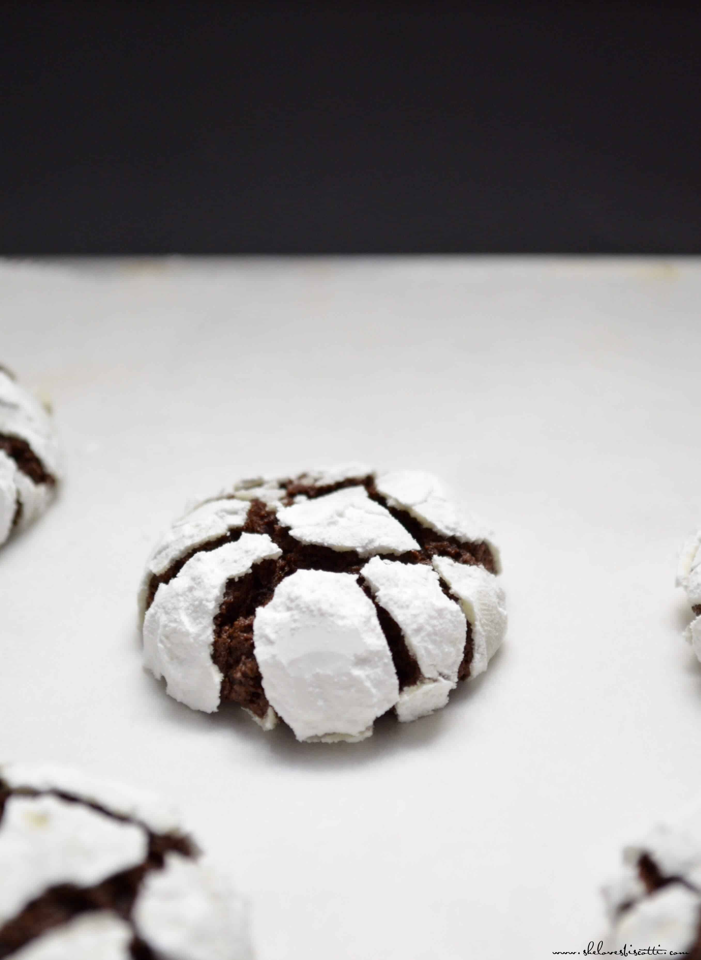 Chocolate snowcap cookies on a white tray.