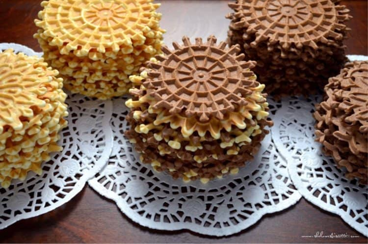Several stacks of Italian wafer cookies are placed on a tray.