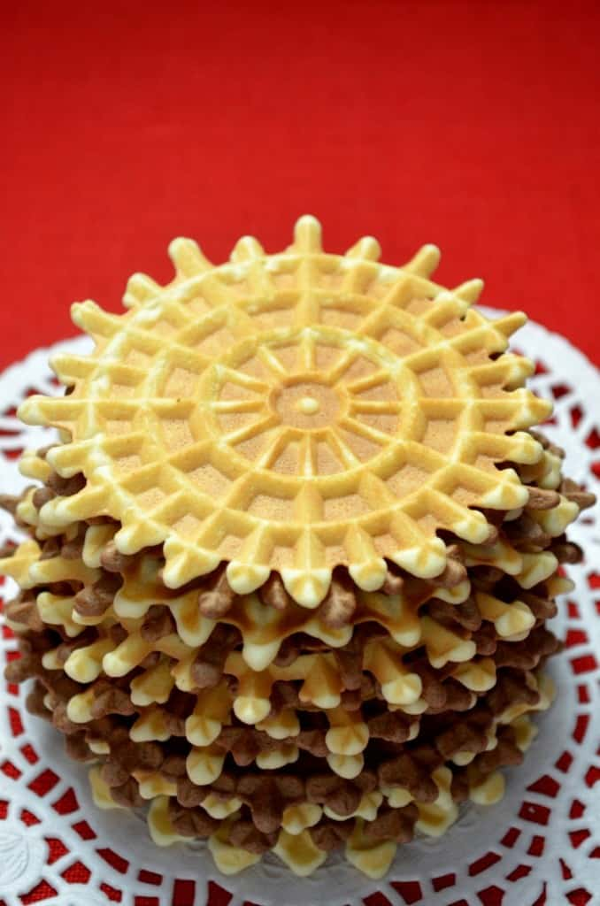 A stack of vanilla and chocolate pizzelle.