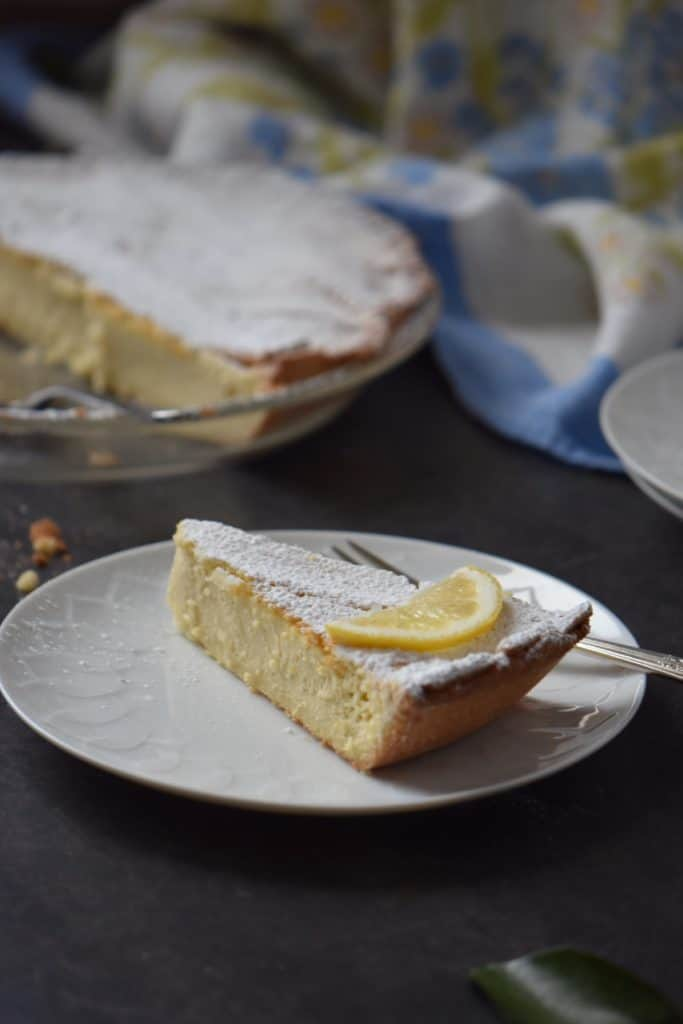 A slice of a traditional Italian Easter Ricotta pie on a white plate.