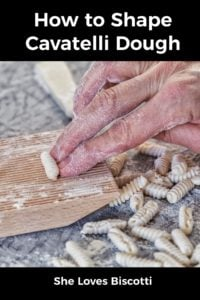Cavatelli being shaped on a wooden grooved board.