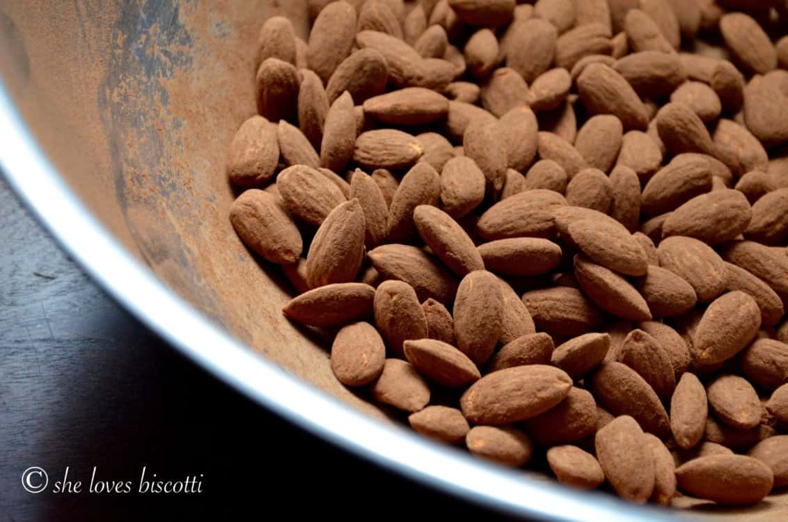Cocoa Dusted Almonds are shown in a stainless steel bowl.