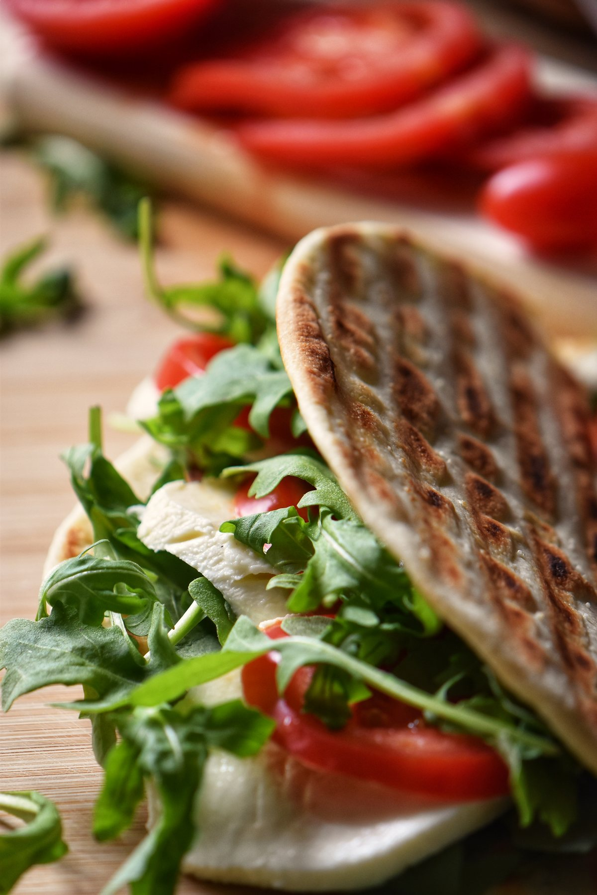 A Vegetarian Piadina Sandwich in a wicker basket.