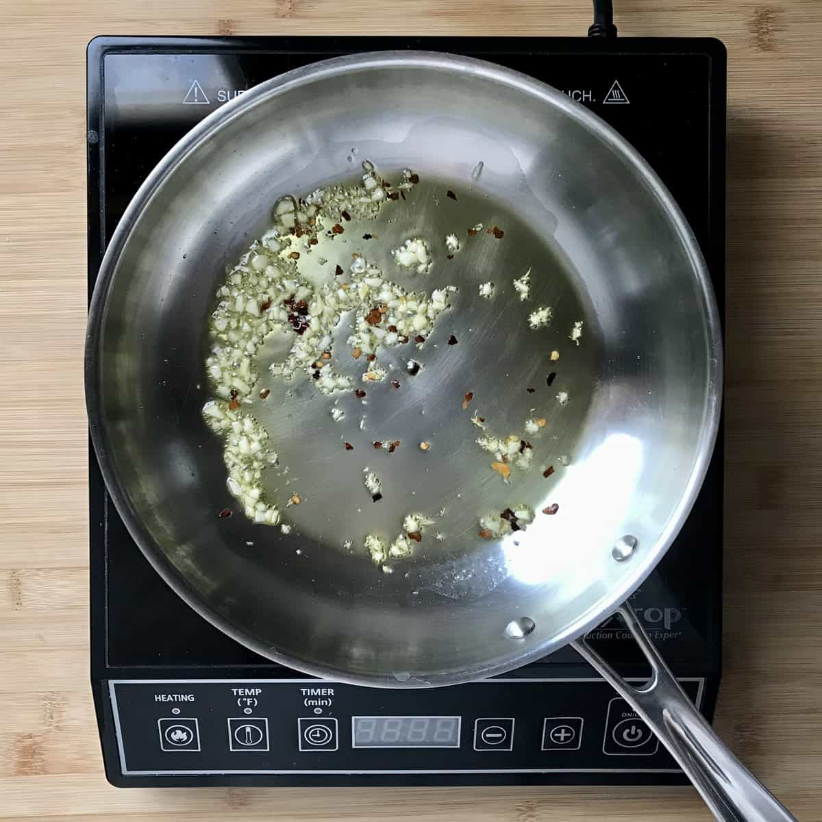 Sauteed garlic in a pan.