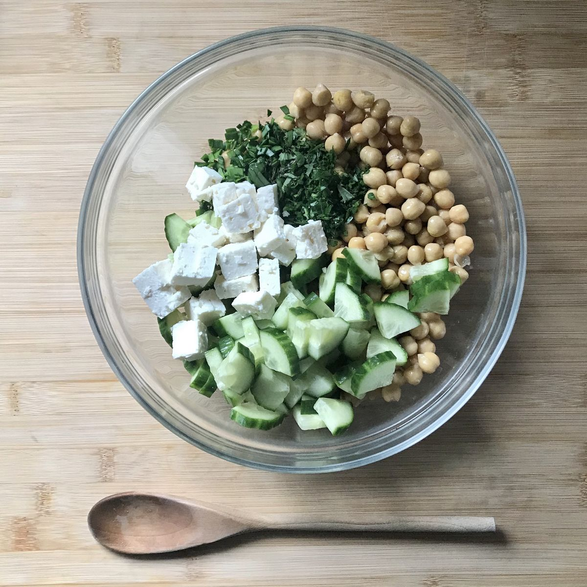 The salad ingredients in a large bowl.
