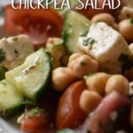 A white bowl with a generous portion of chickpea salad.