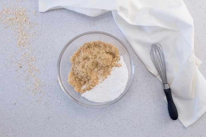 The oat crumble mixture for the date filling in a large bowl.