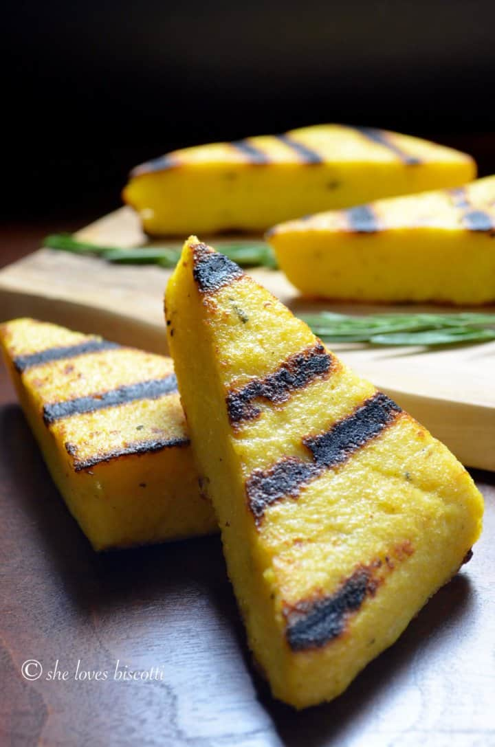 A close up shot of the BBQ markings on a triangular piece of grilled polenta.