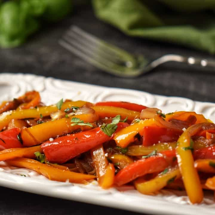 Peperonata in a white serving dish.