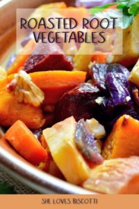 A medley of roasted root vegetables in a sheet pan.