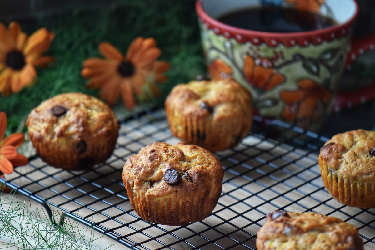 Zucchini muffins on a cooling rack.