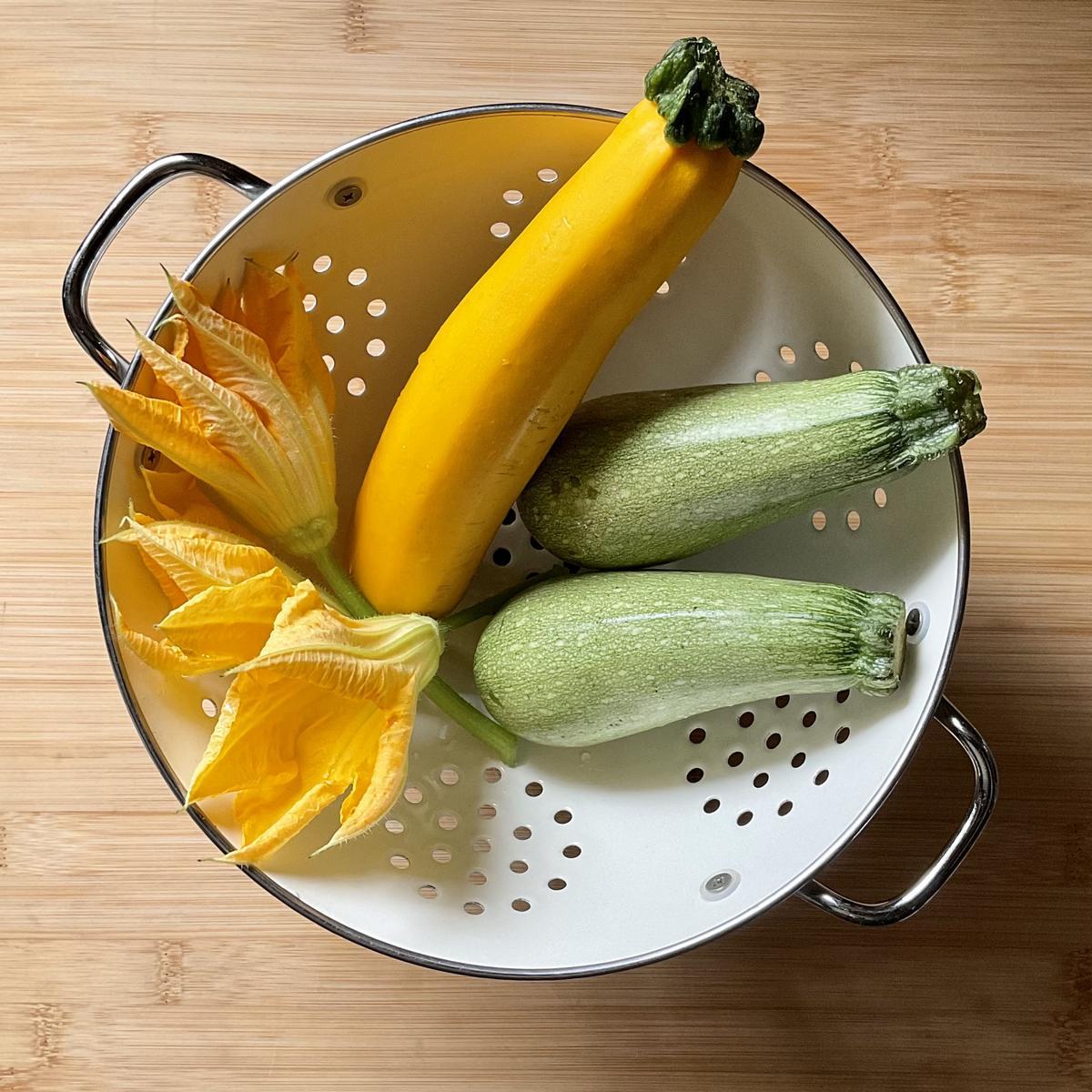 Zucchini in a colander.