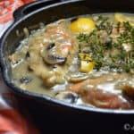 Lemon chicken in a cast iron pan.