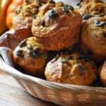 A basket of chocolate chip pumpkin muffins.