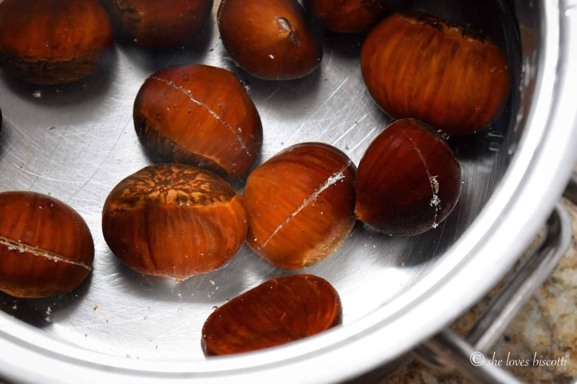 Chestnuts in a pot filled with water.