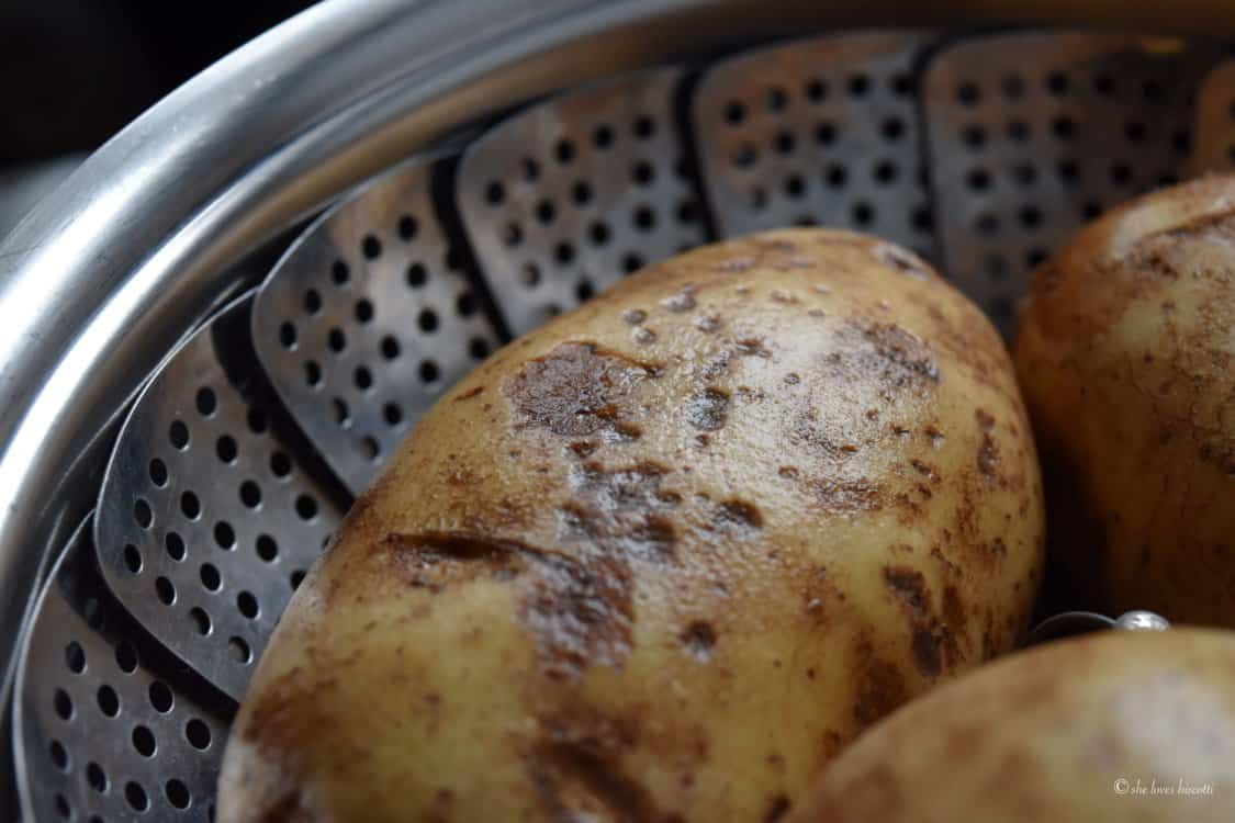 Russet potato is shown in a steamer basket.
