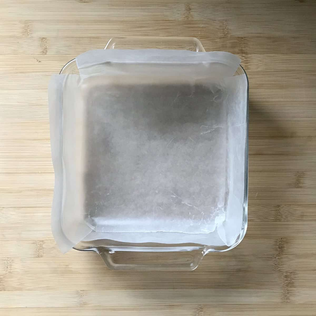 Wax paper lining a square pan.