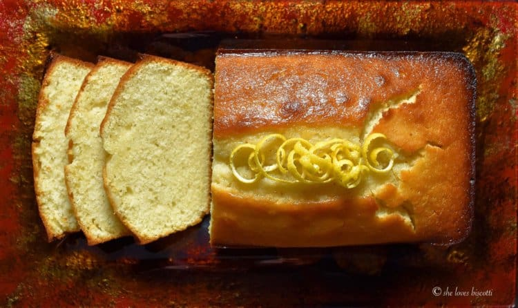 A few pieces of Extra Moist Lemony Lemon Loaf are sliced on a platter.
