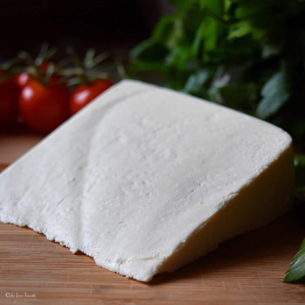 Wedge of the ricotta salata used to make the best Italian salad.