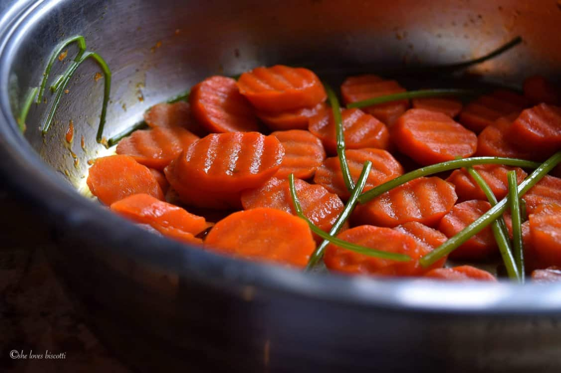 Carrots in the process of being braised.